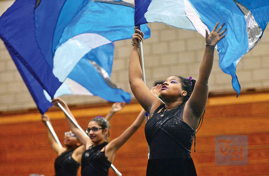Hour photo / Erik Trautmann Benoise Celestin and The Norwalk High School JV Guard perform during the the school's annual Winter Guard and Perscussion Show Saturday.