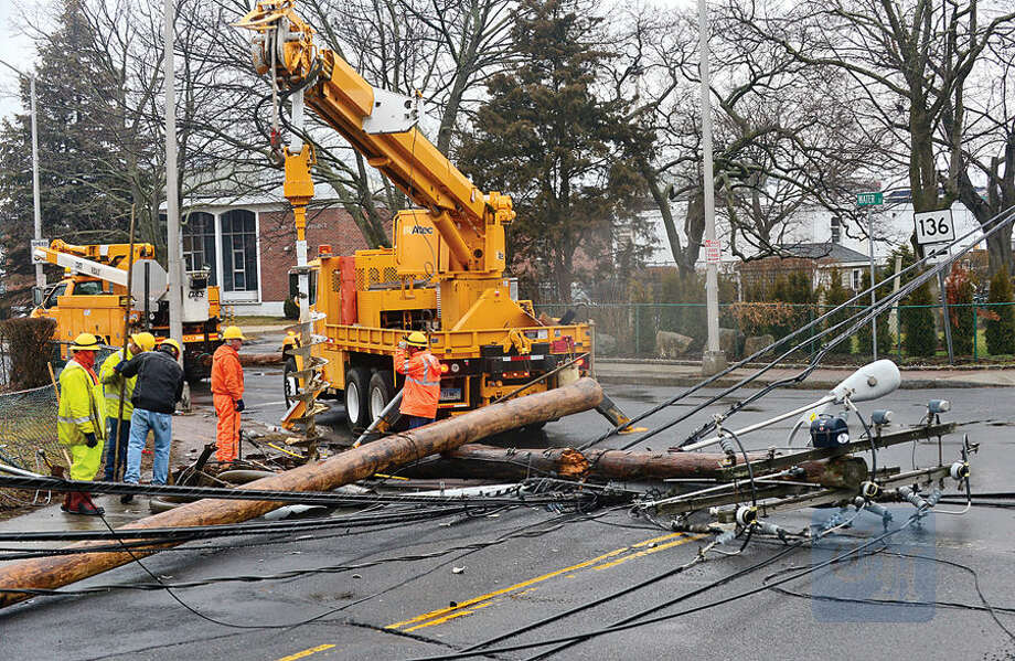 Hour photo / Erik Trautmann Two cars were reportedly in an accident on Quintard Ave that caused a utility pole to fall just after midnight Tuesday shutting down traffic in South Norwalk.