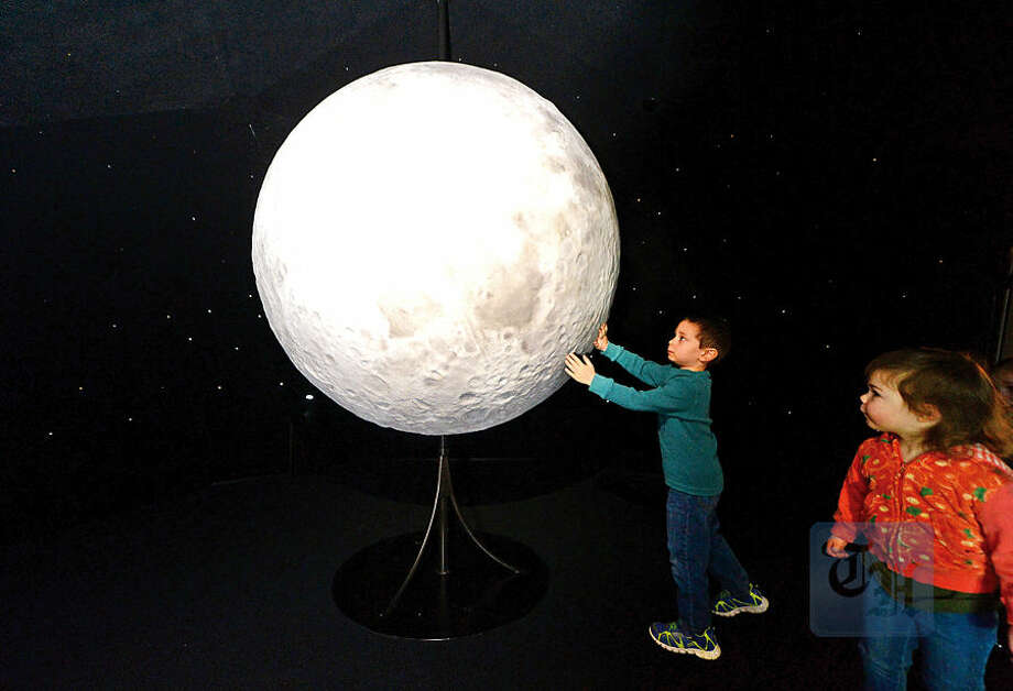 Hour photo / Erik Trautmann Grayson Losovitz, 4, and Casey Craighead, 2, check out a detailed replica of the moon as prt of the amazing planetarium-like exhibit, My Sky, Saturday at the Stepping Stones Museum for Children. My Sky, which is open through Memorial Day, was created by Boston Children's Museum and Smithsonian Astrophysical Observatory and is based upon work supported by NASA.