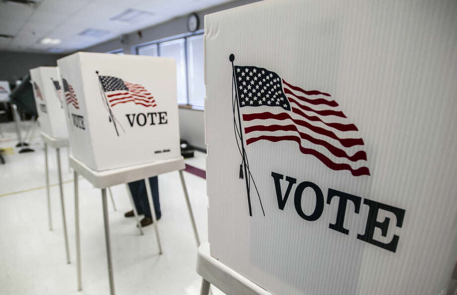 FILE - In this May 20, 2014 file photo, a person votes in the primary election at The Boyle County Fire Department in Danville, KY. The battle for control of the U.S. Senate at stake Tuesday, Nov. 4, 2014, could have far-reaching effects on the economy. (AP Photo/The Advocate Messenger, Clay Jackson, File)