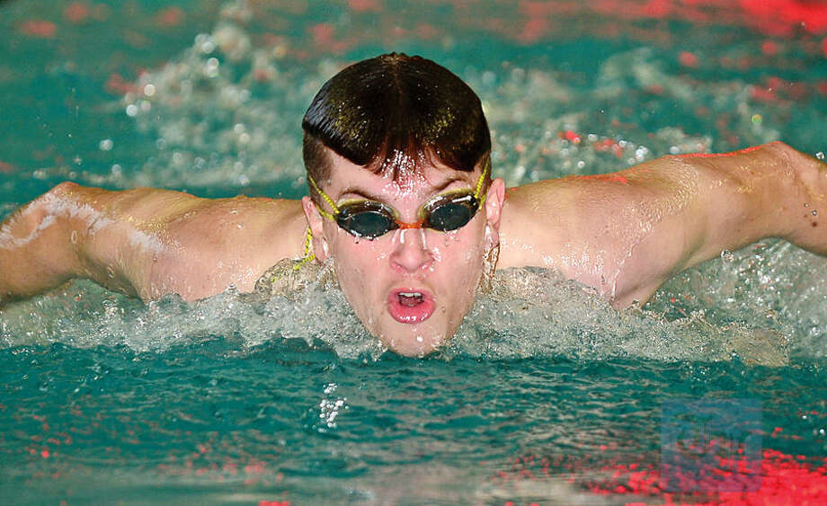 Hour photo / Erik Trautmann Stamford High School/Westikll Co-Op Swim Team's Alex Constantine swims his leg of the 4x100M Butterfly during the Norwalk Relays, a special swim meet being hosted by the McMahon-Norwalk co-op team Saturday at Norwalk High School.