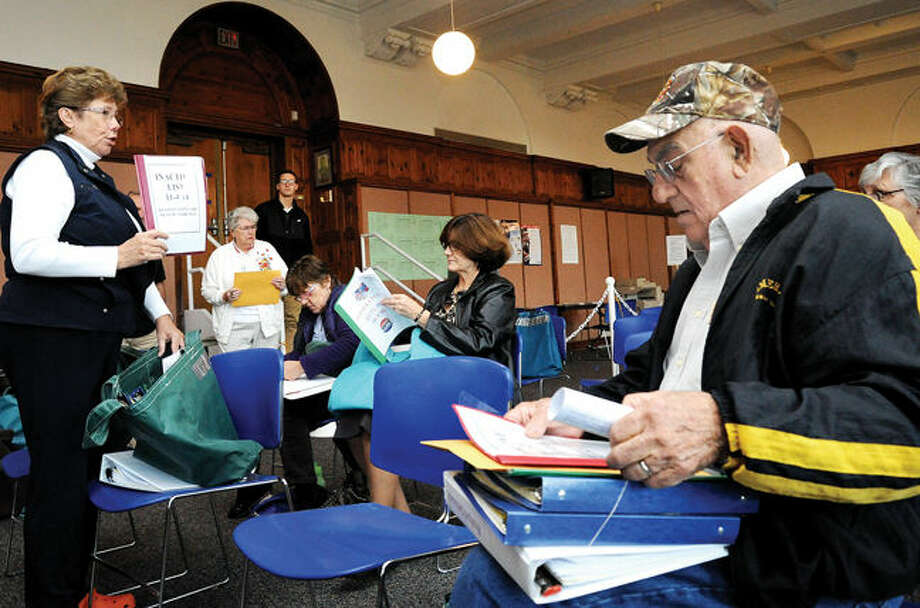 Republican Registar of Voters Karen Doyle Lyons gives instructions at the Norwalk City Hall Community Room Monday for last the moderator training. Jim Ruggiero who will be a moderator at Roton School is among those in attendance. Hour photo/Matthew Vinci