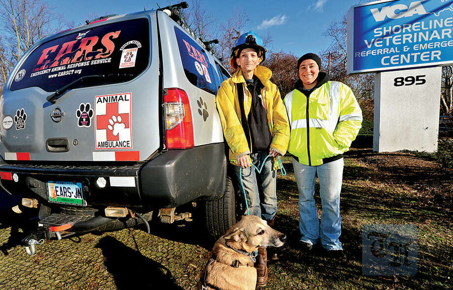 Hour photo / Erik Trautmann Jon Nowinski and Leigh Sylvester of Emergency Animal Repsonse Service (EARS), an emergency veterinary transport service, promote their services at Shoreline Animal Hospital in Shelton Saturday.
