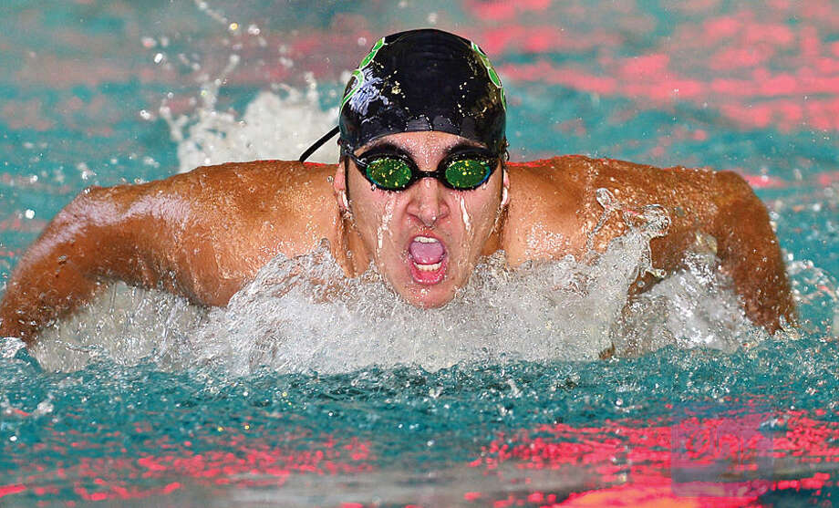 Hour photo / Erik Trautmann Norwalk High School/Brien McMahon Co-Op Swim Team captain Nico Roldan swims his leg of the 4x100M Butterfly during the Norwalk Relays, a special swim meet being hosted by the Norwalk co-op team Saturday at Norwalk High School.