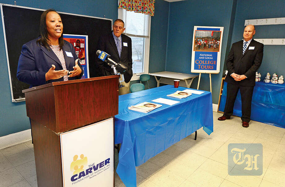 Hour photo / Erik Trautmann Carver Community Center Executive Director Novelette Peterkin announces a gift and grant totaling $500,000 which will be used to build the new Charlotte Naomi Horblit Technology Center during a press conference Thursday.