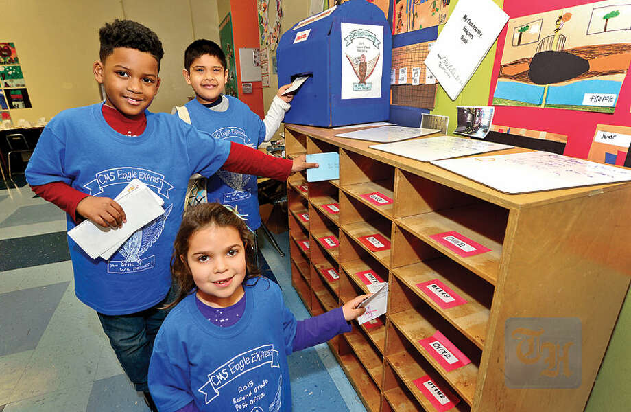 Hour photo / Erik Trautmann This past week Columbus Magnet School organized their annual Eagle Express 2nd Grade Post Office where participating 2nd graders including DeWayne Dickson, Vivian Balzs and Krish Shah, reenacted real life postal jobs, such as clerks, mail sorters, and mail carriers.