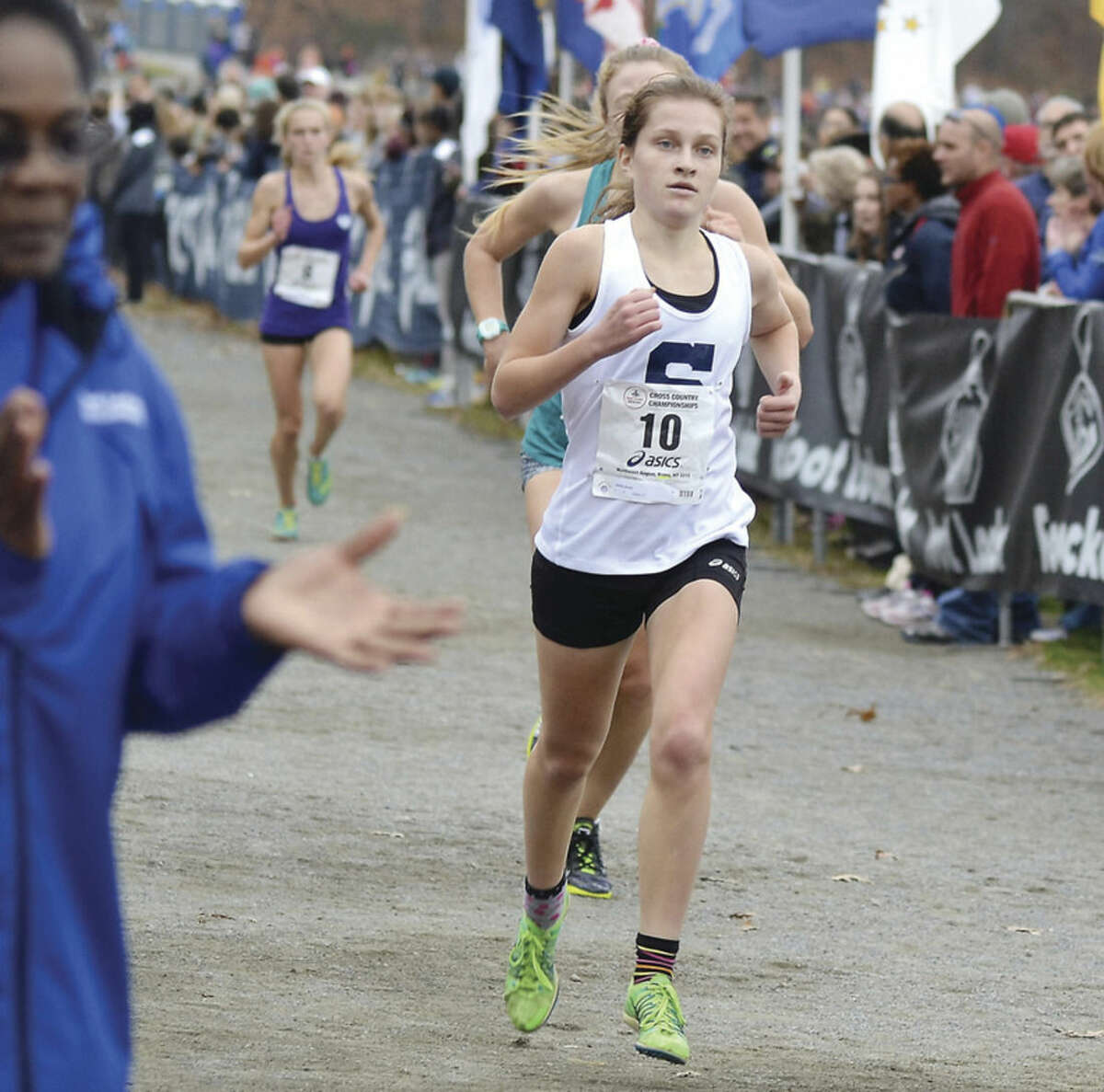 Hour photo/Mary Albl Staples High senior Hannah DeBalsi heads down the stretch to place fourth overall at the Foot Locker Northeast Cross Country Regional Championships on Saturday at Van Cortlandt Park, N.Y.