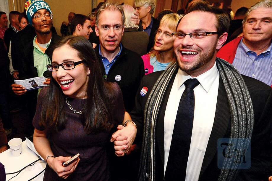 Hour photo / Erik Trautmann Democratic Council candidates Eloisa Melendez and Nick Sacchinelli celebrate election results at the Hilton Garden Inn Tuesday night in Norwalk.
