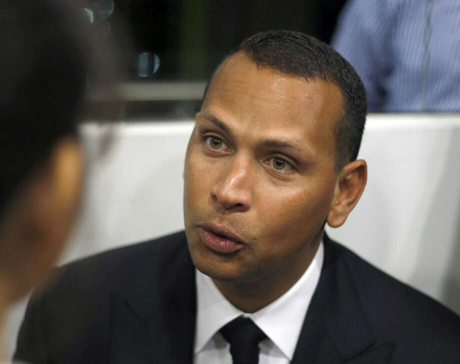 FILE - In this Jan. 16, 2014, file photo, Alex Rodriguez speaks during a news conference in Cancun, Mexico. The U.S. government says New York Yankees star Alex Rodriguez paid his cousin almost $1 million to keep secret Rodriguez's use of performance enhancing drugs. In court documents filed last week in Miami, federal prosecutors say Rodriguez paid $900,000 last year to settle a threatened lawsuit by Yuri Sucart, who had worked as Rodriguez's personal assistant. Sucart, in a letter from his lawyer, threatened to expose Rodriquez's PED use if he wasn't paid $5 million. (AP Photo/Israel Leal, File)