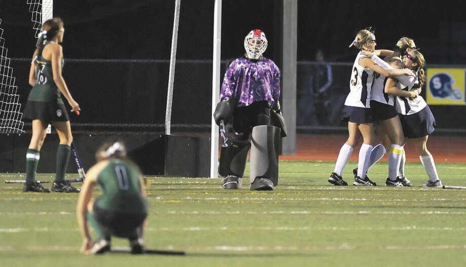 Hour photo/John NashMembers of the Norwalk High field hockey team, from left, Sam Bardos, Grace Bradley and Samantha Troetti are stunned after an overtime goal gave Simsbury a 2-1 win over the Bears in CIAC Class L field hockey first round action on Wednesday.