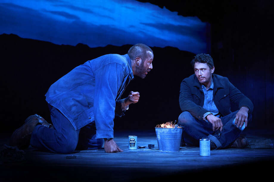 "This image released by Polk & Co. shows James Franco, right, and Chris O'Dowd in a scene from ""Of Mice and Men,"" in New York. A high-definition broadcast of Franco starring on Broadway this summer in John Steinbeck's ""Of Mice and Men"" will compete with the movies ""Nightcrawler"" and ""Gone Girl"" at the box office, and it marks an important milestone. While a few Broadway shows have been broadcast, this is the first time the National Theatre Live series, the gold standard, has chosen a Broadway show to beam into over 900 venues across the U.S. and Canada. (AP Photo/Polk & Co., Richard Phibbs)"