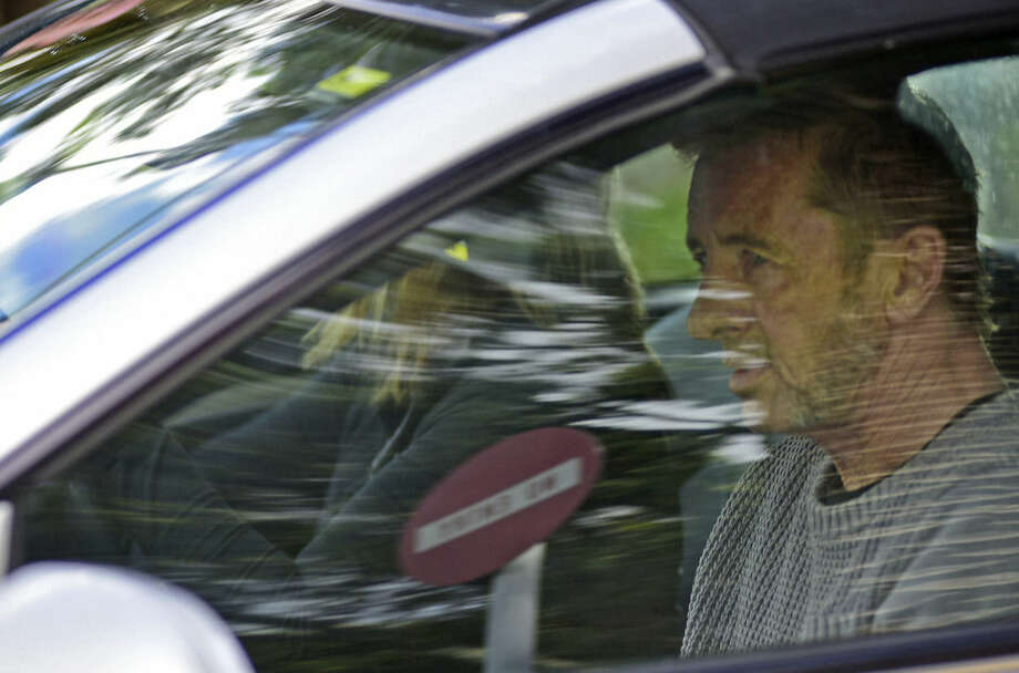Phil Rudd, the drummer for rock band AC/DC, leaves a court house in Tauranga, New Zealand, Thursday, Nov. 6, 2014, after being charged with attempting to procure murder. The 60-year-old has also been charged with threatening to kill and possession of methamphetamine and marijuana. (AP Photo/Bay Of Plenty Times via The New Zealand Herald, George Novak) NEW ZEALAND OUT, AUSTRALIA OUT