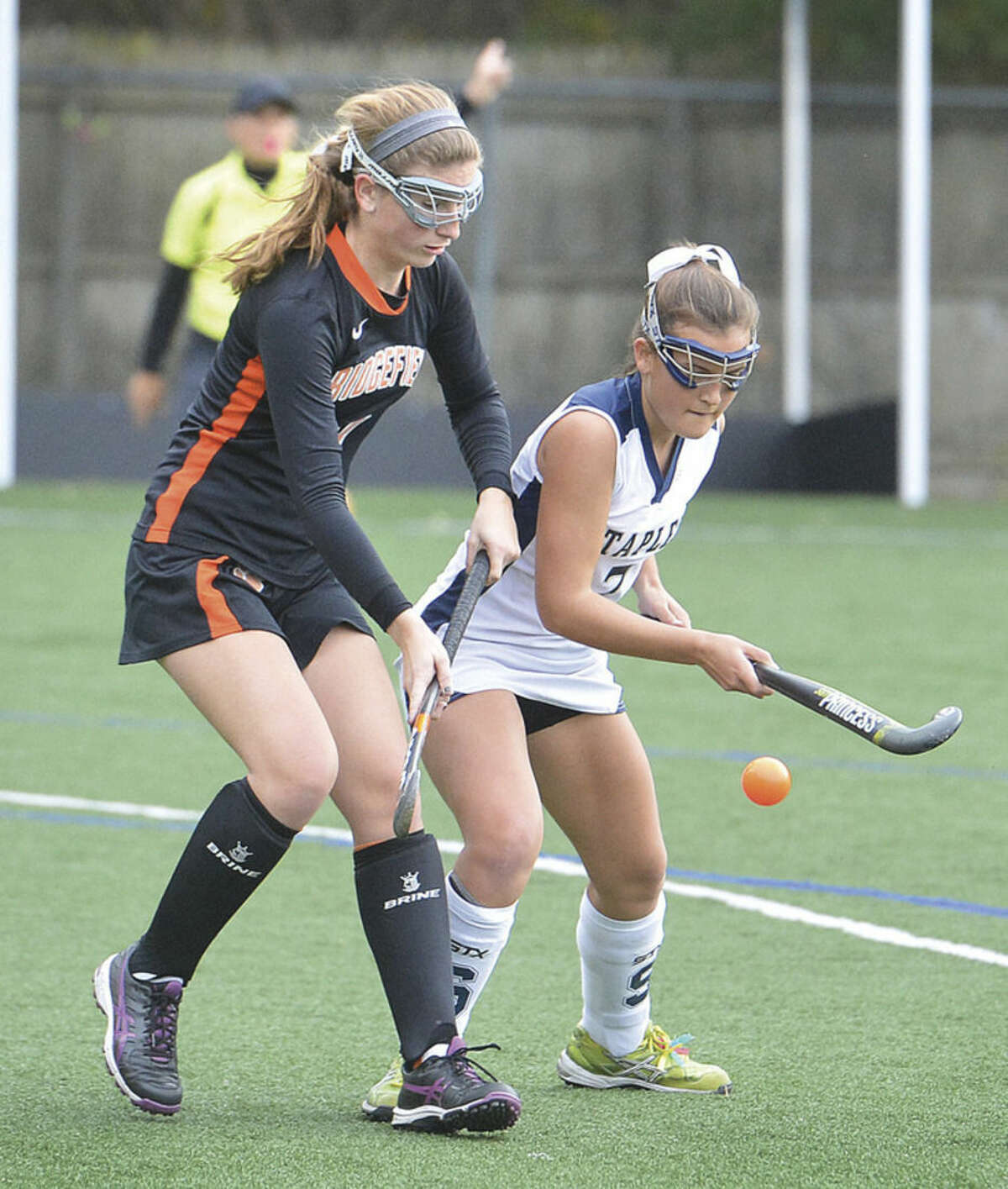 Hour photo/Alex von Kleydorff Staples' Meg Fay tries to settle the ball while Ridgefield's Margot Racy defends during Wednesday's state tournament game.