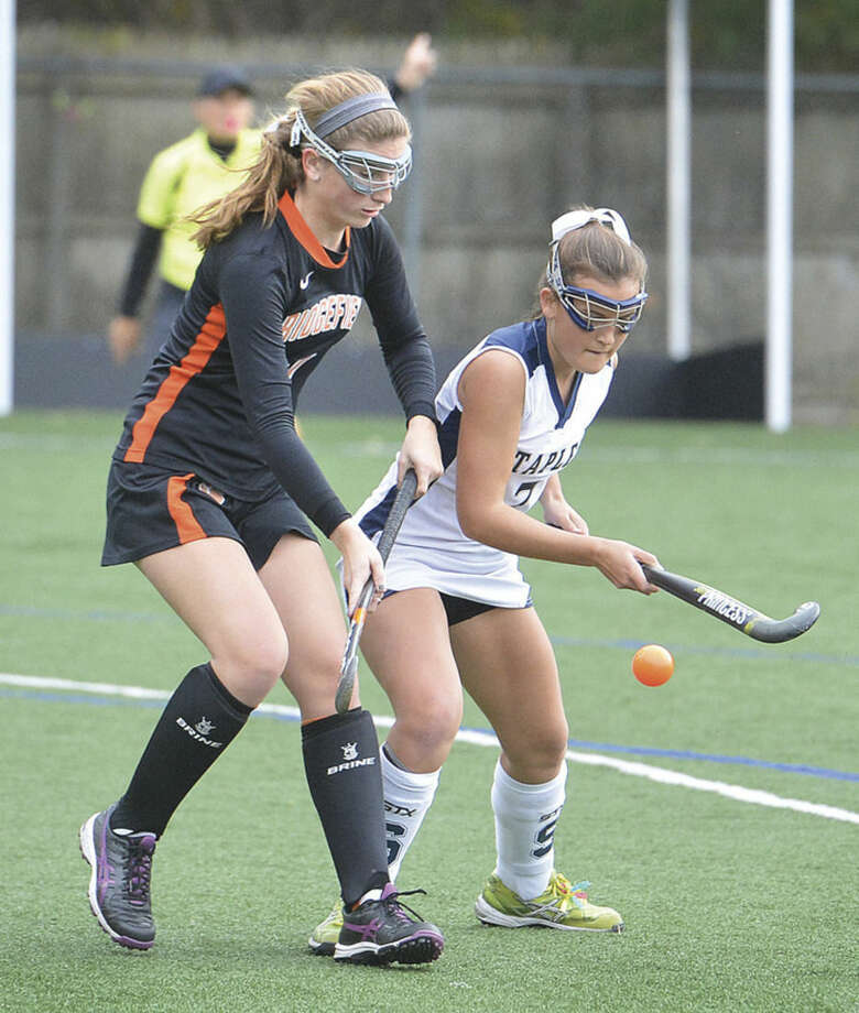 Hour photo/Alex von KleydorffStaples' Meg Fay tries to settle the ball while Ridgefield's Margot Racy defends during Wednesday's state tournament game.
