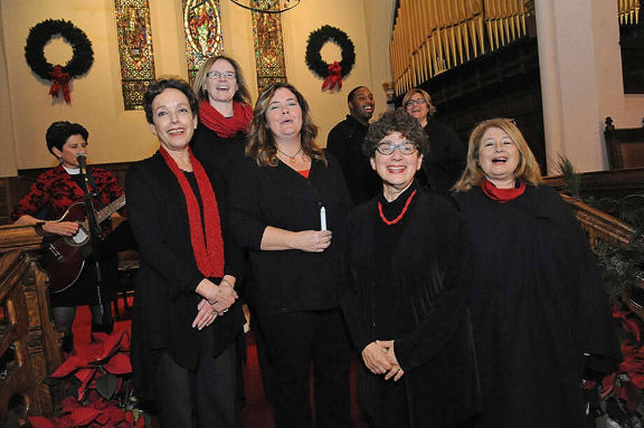 The New World Chorus performs Monday night at the First Congregational Church in Stamford. The church was hosting a memorial for those who have died homeless in the past year.