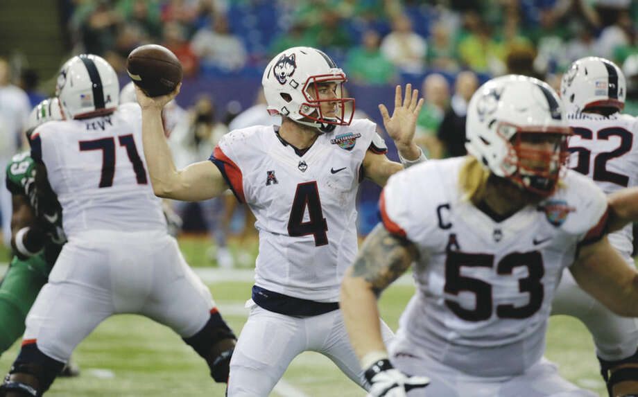 AP photoUConn quarterback Bryant Shirreffs (4) throws a pass against Marshall during the St. Petersburg Bowl on Saturday. Marshall beat UConn 16-10.