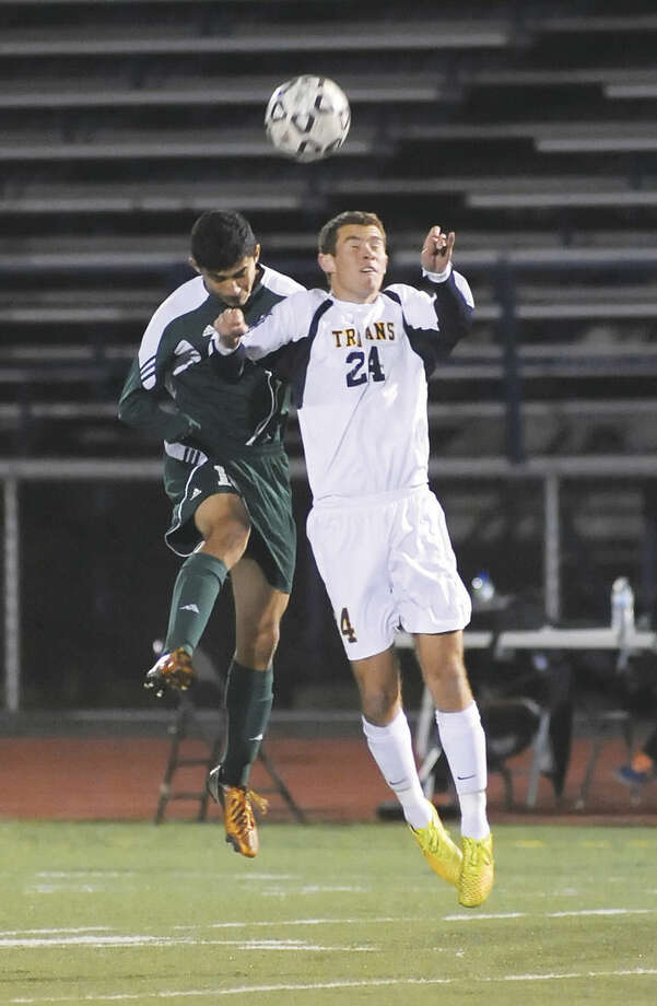 Hour photo/John NashNorwalk's Patrick Barrantes, left, and Simsbury's Steven Moretta battle for a head ball.