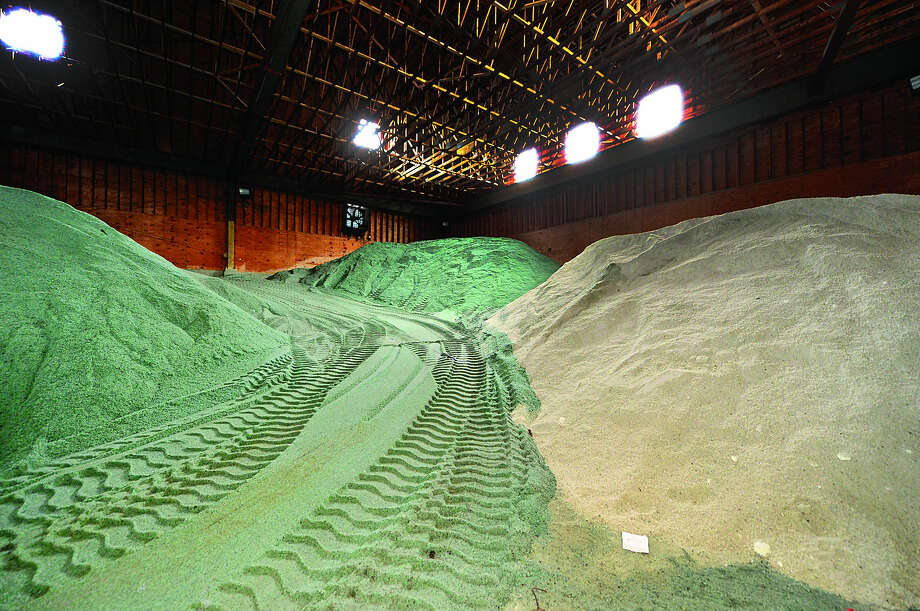 Hour photo / Erik Trautmann Norwalk Department of Public Works salt shed remains well-stocked with salt mixtures due to the unseasonably warm weather.