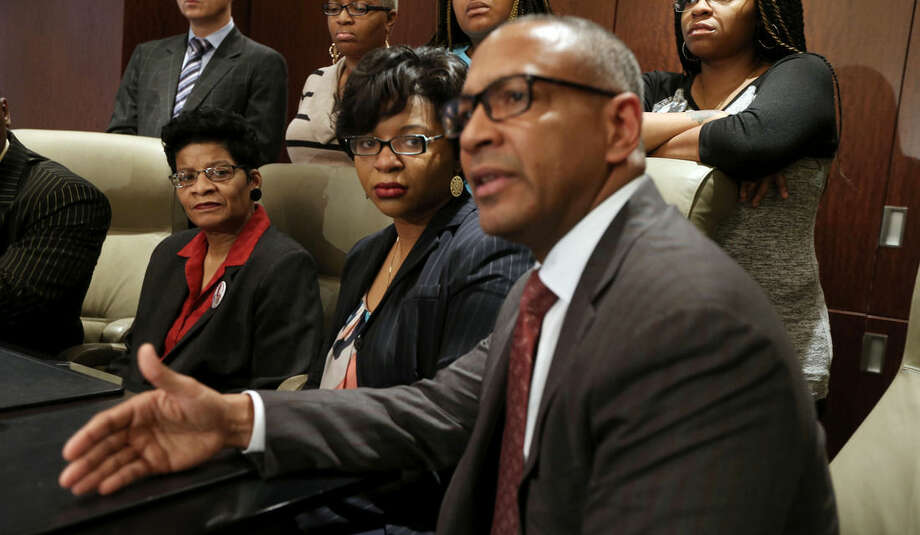 Geneva Reed-Veal, left, and Sharon Cooper, center, the mother and sister of Sandra Bland, listen to attorney Larry Rogers Jr., right, explain concerns about the Texas grand jury's role in the death of Naperville resident Sandra Bland, Monday, Dec. 21, 2015 in Chicago. As a grand jury investigates the case of Sandra Bland, a black woman whose death in a Texas jail shook a raw year in American policing, the state police force at the center of her combative traffic stop is able to shield some complaints under special exemptions and has used what experts say are outdated practices for keeping nearly 4,000 troopers in check. (Phil Velasquez/Chicago Tribune via AP) MANDATORY CREDIT CHICAGO TRIBUNE; CHICAGO SUN-TIMES OUT; DAILY HERALD OUT; NORTHWEST HERALD OUT; THE HERALD-NEWS OUT; DAILY CHRONICLE OUT; THE TIMES OF NORTHWEST INDIANA OUT; TV OUT; MAGS OUT; NO SALES