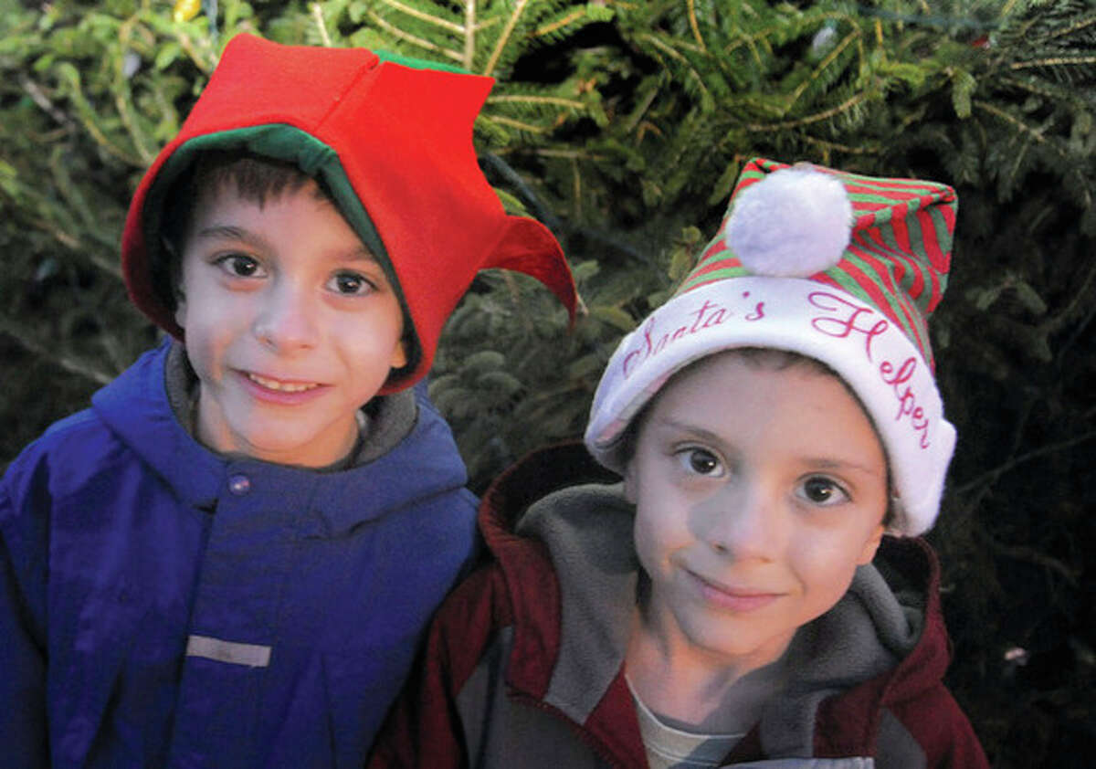 Twins Christopher and William Maslar 6, at the American Legion Post 12 annual Christmas lighting in Norwalk on Sunday. Hour photo/Matthew Vinci