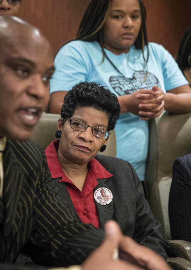 Cannon Lambert Sr., left, attorney for Sandra Bland's family, speaks at a news conference Monday, Dec. 21, 2015 in Chicago. Bland's family says they have no faith in a grand jury that's considering criminal indictments in her death in a Texas jail last summer. The family criticized the grand jury proceedings in Waller County, Texas. Lambert talks to reporters as Sharon Bland stands behind her mother Geneva Reed-Veal, center. (Rich Hein/Chicago Sun-Times via AP) MANDATORY CREDIT, MAGS OUT, NO SALES; CHICAGO TRIBUNE OUT