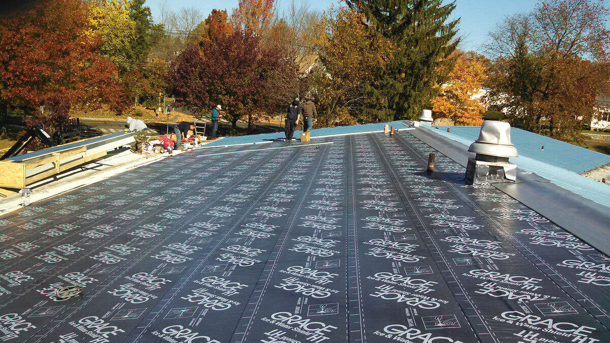 Contributed photo A water tight membrane is installed along with a new metal roof at Kendall Elementary School.