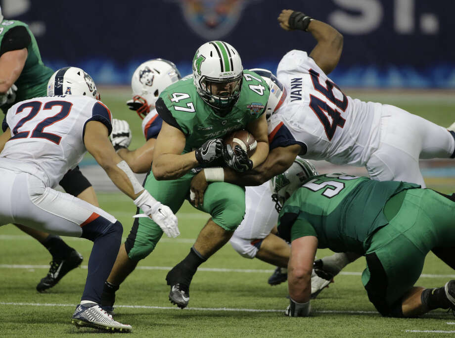 Marshall running back Devon Johnson (47) finds a hole against Connecticut during the St. Petersburg Bowl NCAA college football game Saturday, Dec. 26, 2015, in St. Petersburg, Fla. (AP Photo/Chris O'Meara)