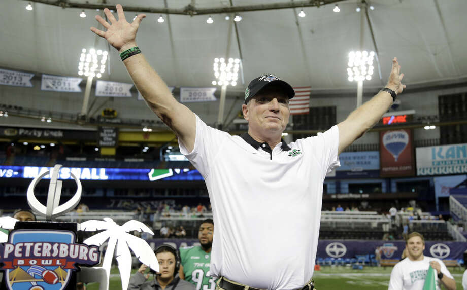 Marshall head coach Doc Holliday celebrates the team's 16-10 win against Connecticut during the St. Petersburg Bowl NCAA college football game Saturday, Dec. 26, 2015, in St. Petersburg, Fla. (AP Photo/Chris O'Meara)