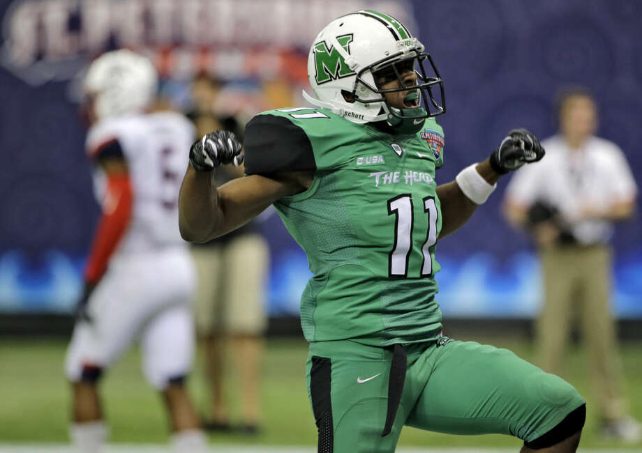 Marshall defensive back Rodney Allen (11) celebrates after breaking up a fourth down pass against Connecticut during the second half of the St. Petersburg Bowl NCAA college football game Saturday, Dec. 26, 2015, in St. Petersburg, Fla. Marshall won the game 16-10. (AP Photo/Chris O'Meara)