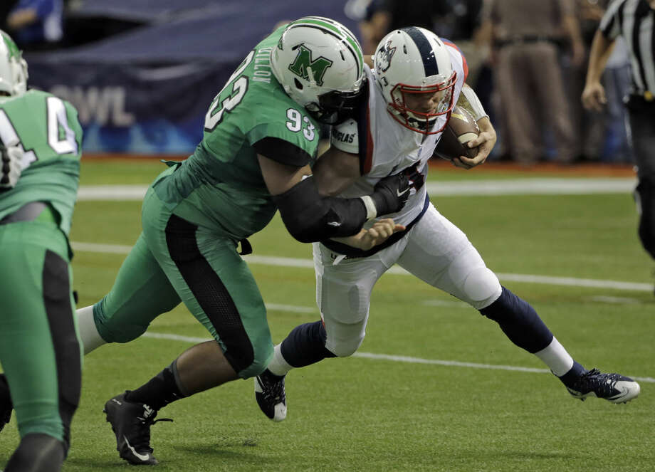 Marshall defensive lineman Steve Dillon (93) sacks Connecticut quarterback Bryant Shirreffs during the St. Petersburg Bowl NCAA college football game Saturday, Dec. 26, 2015, in St. Petersburg, Fla. (AP Photo/Chris O'Meara)