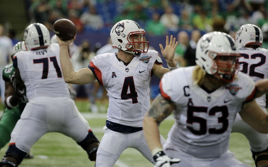 Connecticut quarterback Bryant Shirreffs (4) throws a pass against Marshall during the St. Petersburg Bowl NCAA college football game Saturday, Dec. 26, 2015, in St. Petersburg, Fla. (AP Photo/Chris O'Meara)