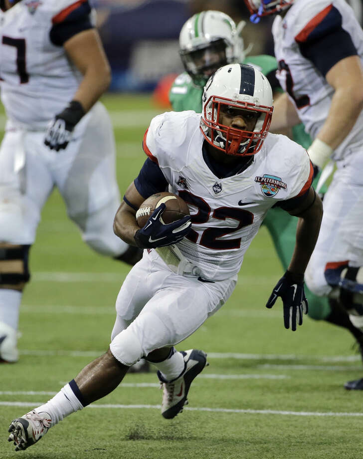 Connecticut running back Arkeel Newsome (22) runs against Marshall during the St. Petersburg Bowl NCAA college football game Saturday, Dec. 26, 2015, in St. Petersburg, Fla. (AP Photo/Chris O'Meara)