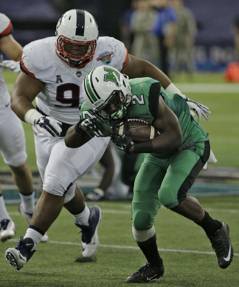 Marshall wide receiver Hyleck Foster (2) cuts in front of Connecticut defensive lineman Mikal Myers (92) during the St. Petersburg Bowl NCAA college football game Saturday, Dec. 26, 2015, in St. Petersburg, Fla. (AP Photo/Chris O'Meara)