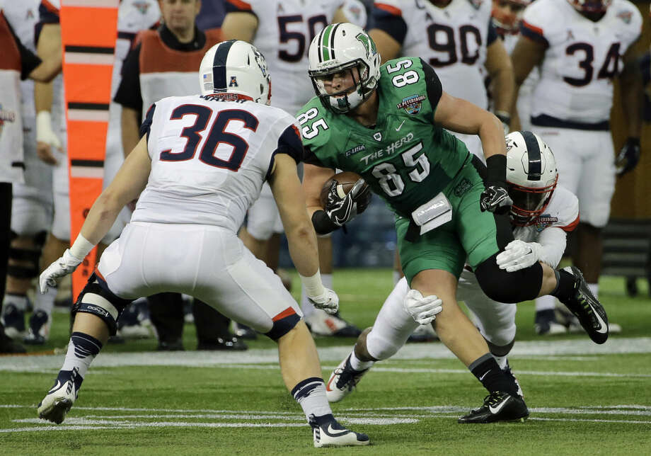 Marshall tight end Ryan Yurachek (85) runs at Connecticut linebacker Matthew Walsh (36) after a reception during the St. Petersburg Bowl NCAA college football game Saturday, Dec. 26, 2015, in St. Petersburg, Fla. (AP Photo/Chris O'Meara)