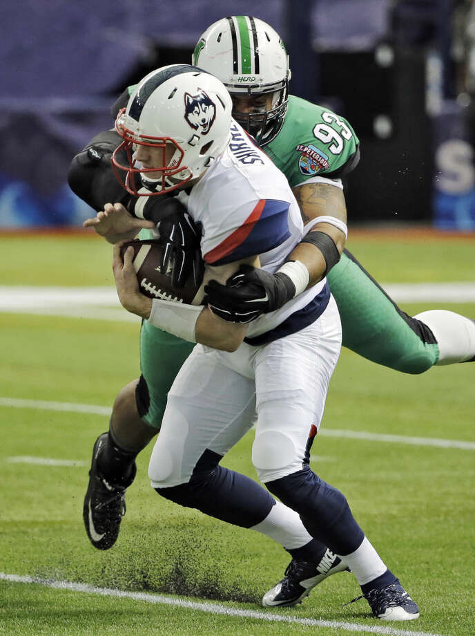 Connecticut quarterback Bryant Shirreffs (4) is sacked by Marshall defensive lineman Steve Dillon (93) during the first quarter of the St. Petersburg Bowl NCAA college football game, Saturday, Dec. 26, 2015, in St. Petersburg, Fla. (AP Photo/Chris O'Meara)