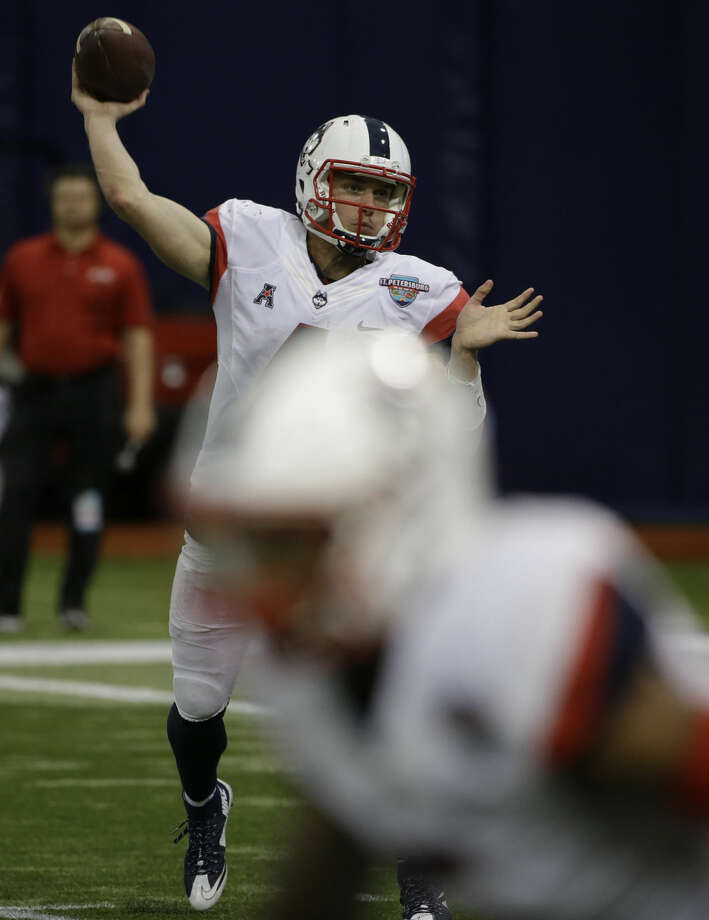 Connecticut quarterback Bryant Shirreffs throws a pass against Marshall during the St. Petersburg Bowl NCAA college football game Saturday, Dec. 26, 2015, in St. Petersburg, Fla. (AP Photo/Chris O'Meara)