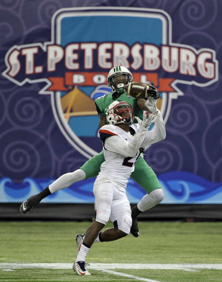Connecticut cornerback Jamar Summers (21) intercepts a pass intended for Marshall wide receiver Davonte Allen (3) during the second half of the St. Petersburg Bowl NCAA college football game Saturday, Dec. 26, 2015, in St. Petersburg, Fla. (AP Photo/Chris O'Meara)