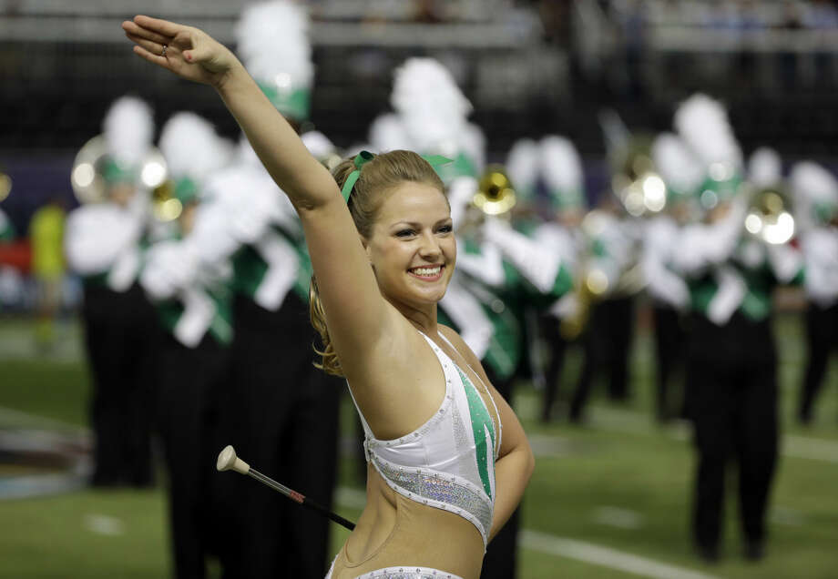 A Marshall majorette during the St. Petersburg Bowl NCAA college football game against Connecticut Saturday, Dec. 26, 2015, in St. Petersburg, Fla. (AP Photo/Chris O'Meara)