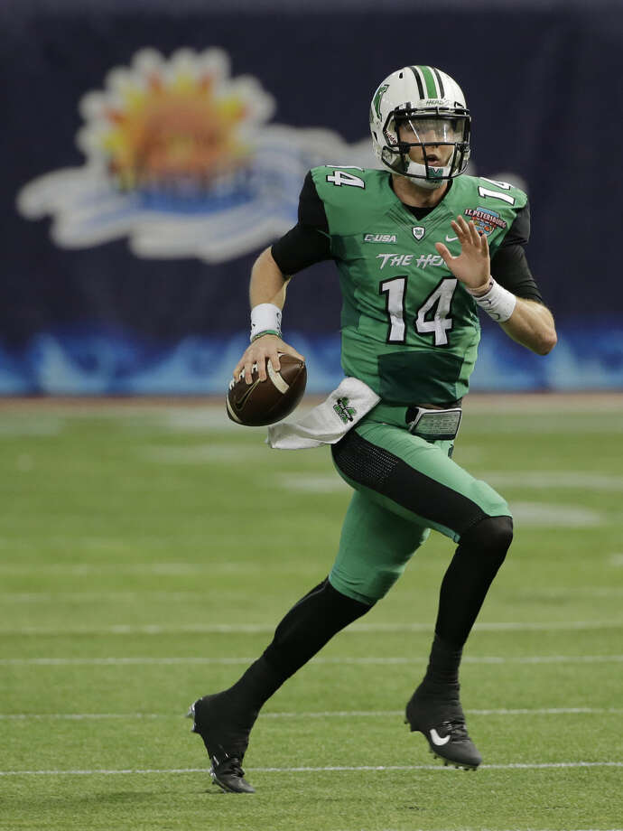 Marshall quarterback Chase Litton runs against Connecticut during the St. Petersburg Bowl NCAA college football game Saturday, Dec. 26, 2015, in St. Petersburg, Fla. (AP Photo/Chris O'Meara)