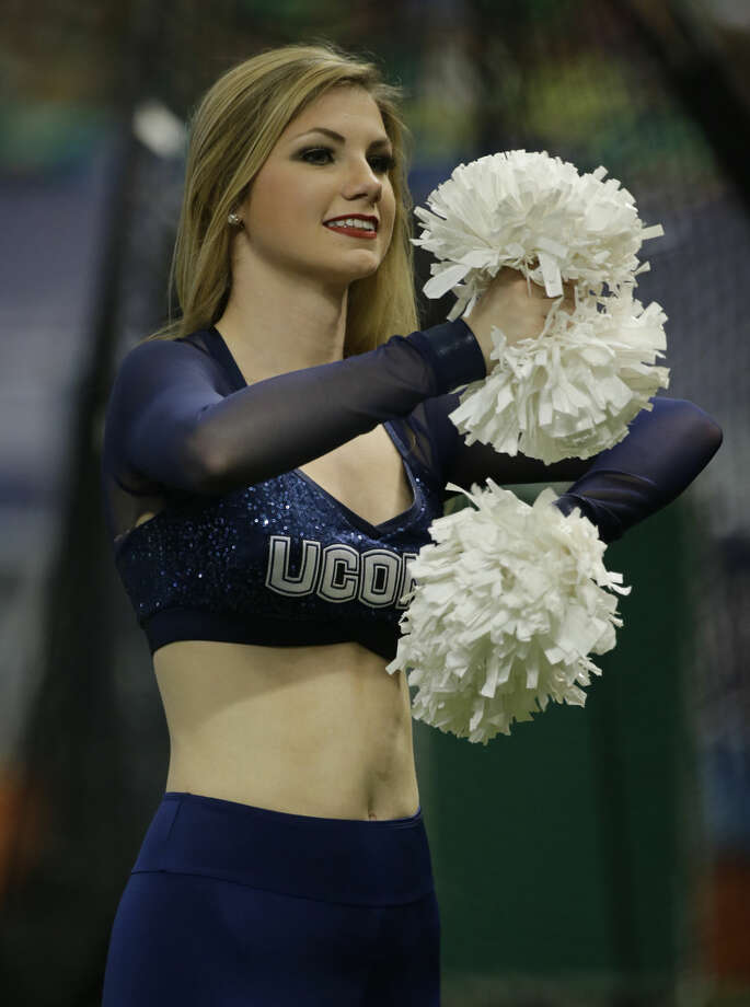 A Connecticut cheerleader during the St. Petersburg Bowl NCAA college football game against Marshall Saturday, Dec. 26, 2015, in St. Petersburg, Fla. (AP Photo/Chris O'Meara)