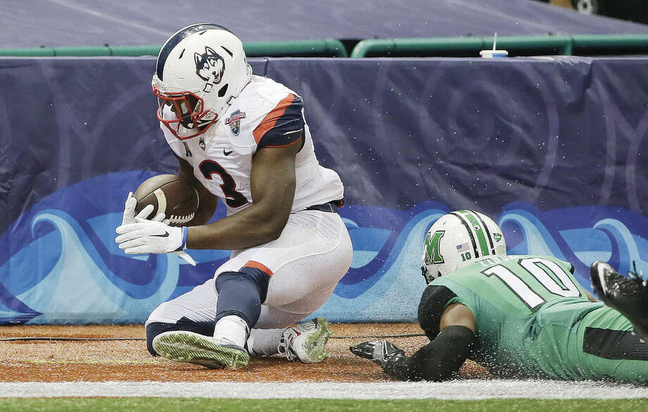 AP photoUConn running back Ron Johnson (3) runs into the end zone after getting past Marshall defensive back Corey Tindal (10) to score during the first quarter of Saturday's St. Petersburg Bowl in St. Petersburg, Fla. The Huskies lost to Marshall but they have many key players from the team returning next season.
