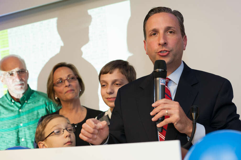 Hour photo/Chris Palermo. Senator Bob Duff, accompanied by his family, gives his victory speech Tuesday night at the Hilton Garden Inn Democrat party.2