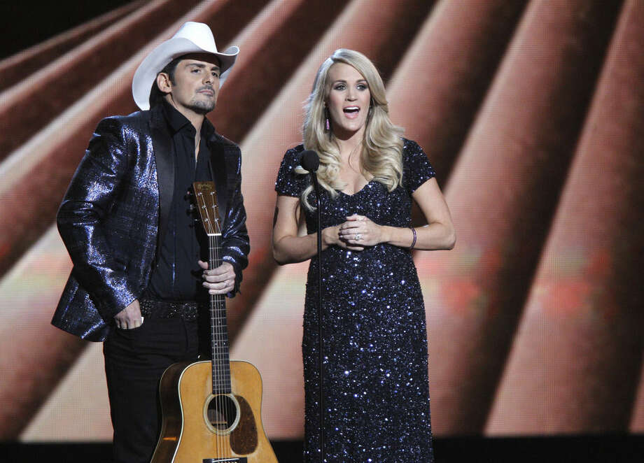 Hosts Brad Paisley, left, and Carrie Underwood speak onstage at the 48th annual CMA Awards at the Bridgestone Arena on Wednesday, Nov. 5, 2014, in Nashville, Tenn. (Photo by Wade Payne/Invision/AP)