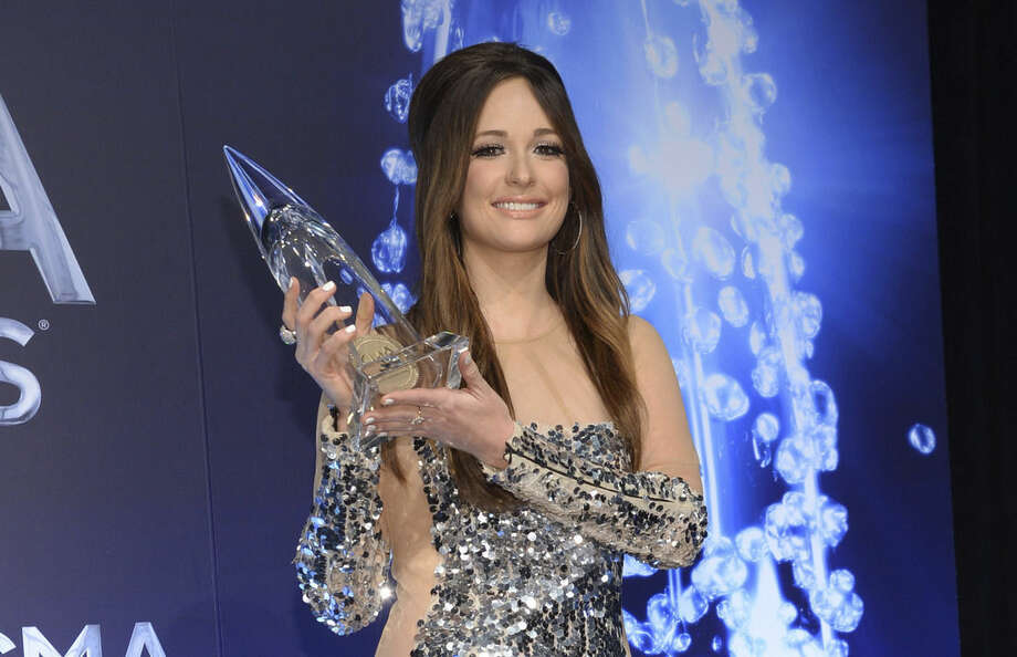 "Kacey Musgraves poses in the press room with the song of the year award for ""Follow Your Arrow"" at the 48th annual CMA Awards at the Bridgestone Arena on Wednesday, Nov. 5, 2014, in Nashville, Tenn. (Photo by Evan Agostini/Invision/AP)"