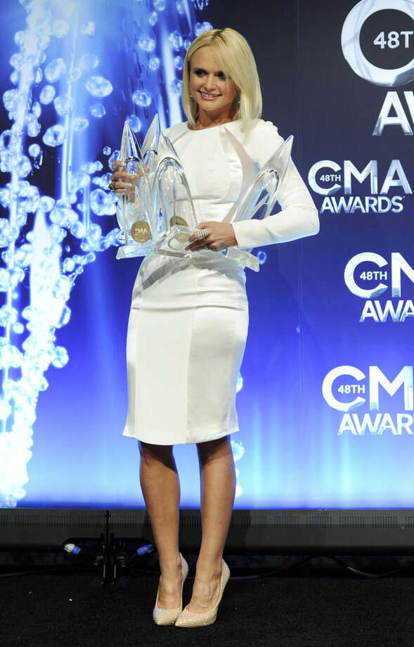 Miranda Lambert poses in the press room with the award for album of the year for Platinum at the 48th annual CMA Awards at the Bridgestone Arena on Wednesday, Nov. 5, 2014, in Nashville, Tenn. (Photo by Evan Agostini/Invision/AP)