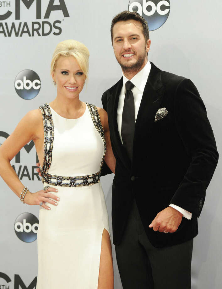 Caroline Boyer, left, and Luke Bryan arrive at the 48th annual CMA Awards at the Bridgestone Arena on Wednesday, Nov. 5, 2014, in Nashville, Tenn. (Photo by Evan Agostini/Invision/AP)