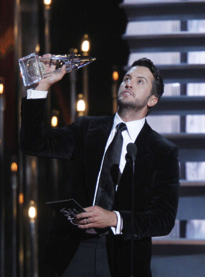 Luke Bryan accepts the award for entertainer of the year onstage at the 48th annual CMA Awards at the Bridgestone Arena on Wednesday, Nov. 5, 2014, in Nashville, Tenn. (Photo by Wade Payne/Invision/AP)