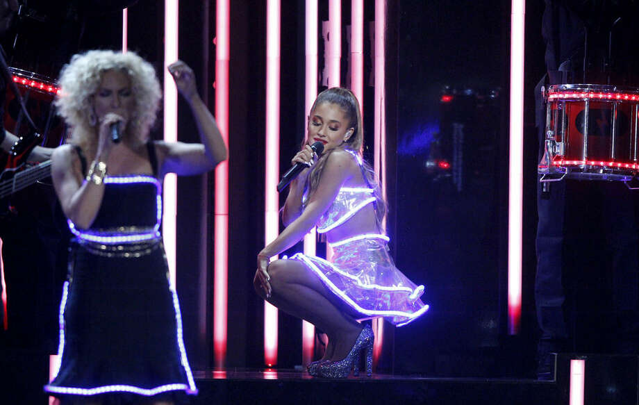 Kimberly Schlapman, of the musical group Little Big Town, left, and Ariana Grande perform on stage at the 48th annual CMA Awards at the Bridgestone Arena on Wednesday, Nov. 5, 2014, in Nashville, Tenn. (Photo by Wade Payne/Invision/AP)