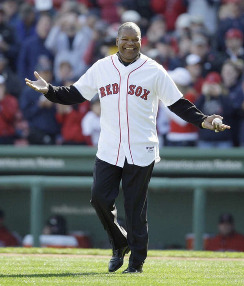 FILE - This Oct. 11, 2009 file photo shows former Boston Red Sox outfielder Dave Henderson walking onto the field to throw out the ceremonial first pitch before Game 3 of an American League baseball division series between the Boston Red Sox and Los Angeles Angels in Boston. Henderson, who hit one of the most famous home runs in postseason history, died Sunday, Dec. 27, 2015, after suffering a massive heart attack. He was 57. (AP Photo/Charles Krupa, file)