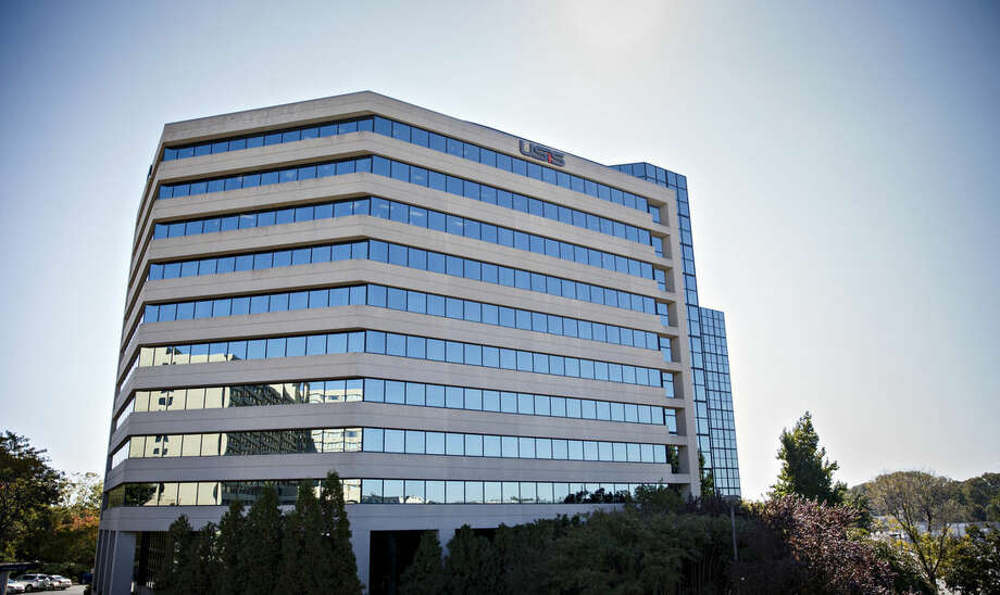 In this photo taken Oct. 17, 2014, the USIS building in Falls Church, Va. A cyber-attack similar to previous hacker intrusions from China penetrated computer networks for months at USIS, the government's leading security clearance contractor, before the company noticed the break-in, officials and others familiar with an FBI investigation and related official inquiries told The Associated Press. The breach compromised the private records of at least 25,000 employees at the Homeland Security Department and cost the company hundreds of millions of dollars in lost government contracts. (AP Photo/J. Scott Applewhite)